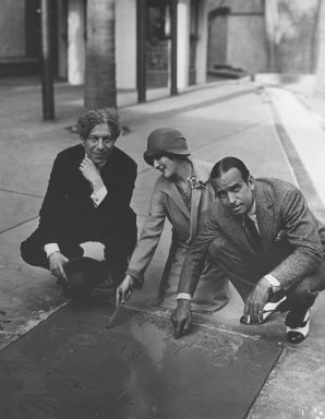 Sid Grauman, Mary Pickford & Douglas Fairbanks at Mary & Douglas's cement signing. They were the first people to have their prints and signatures added to the Chinese Theater courtyard.